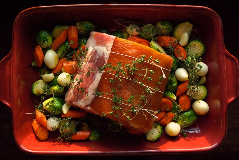 A pork rib roast with fall vegetables ready to go into the oven.